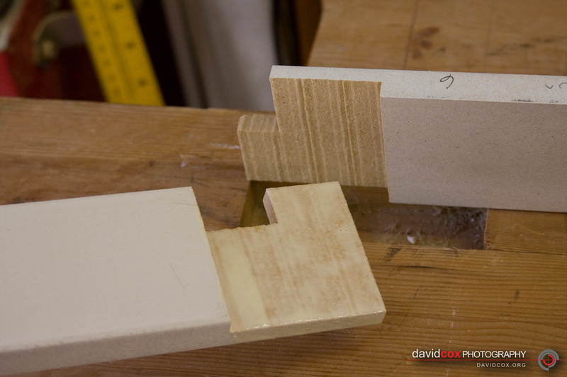 Closeup of glue-up of half-lap joints for 3d torsion box assembly for stacking cabinets