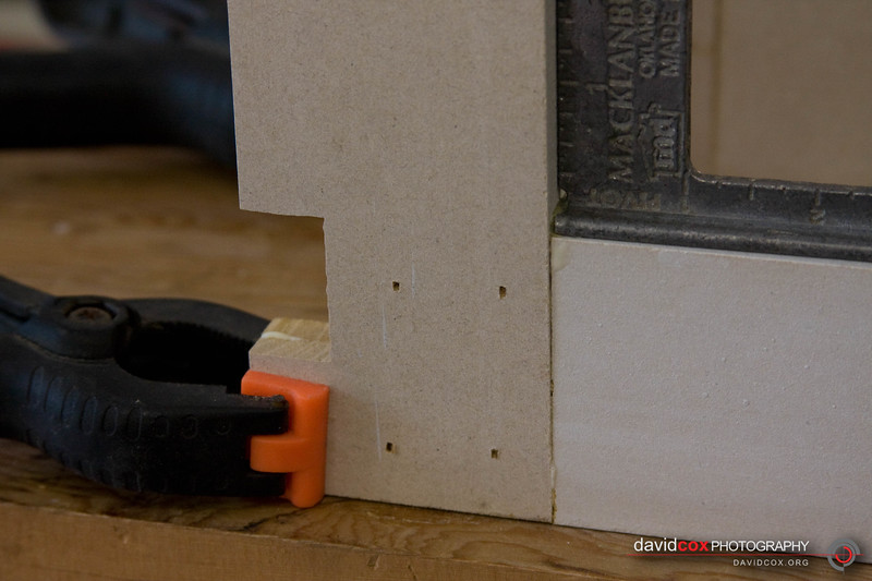 close up of clamp-up assembly of half-lap joint in 3d torsion box made from MDF