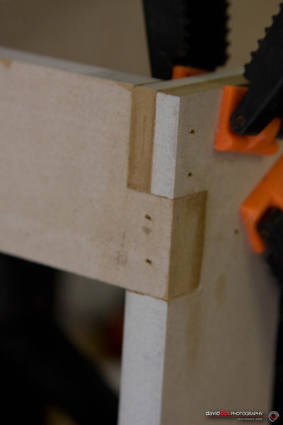 Closeup of 3-way half-lap joint of 3D MDF torsion box assembly for stacking cabinet furniture