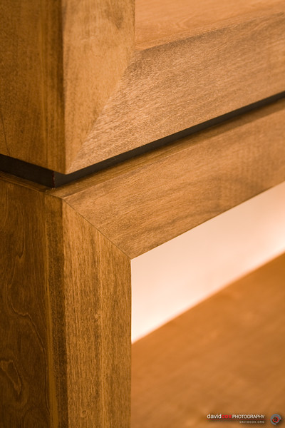 detail of face frame and black spacer runner on stacking modular furniture cabinets